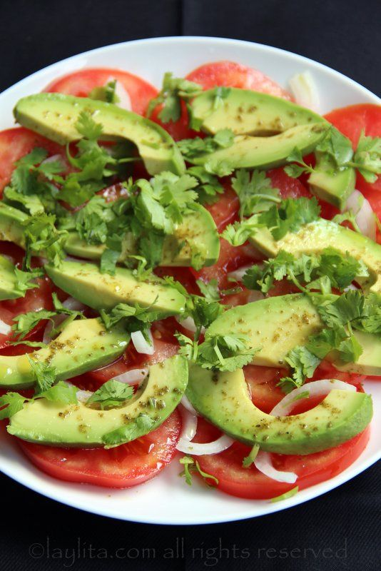 Simple (yet delicious) avocado and tomato salad made with ripe tomatoes, avocado, onion, cilantro, lime juice, olive oil, and salt.