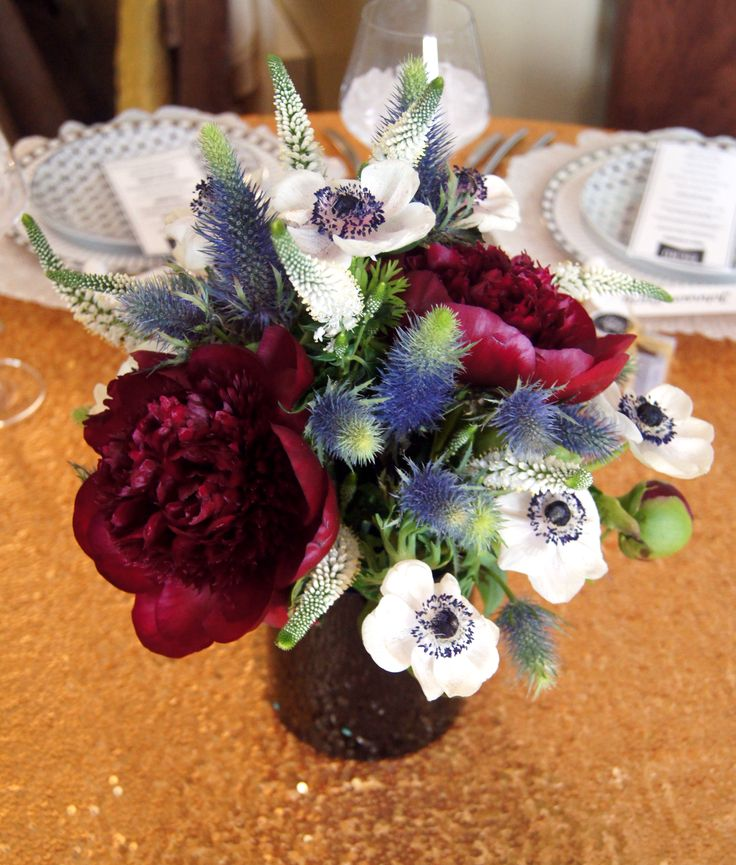 Burgundy peonies anemones and thistle red white blue