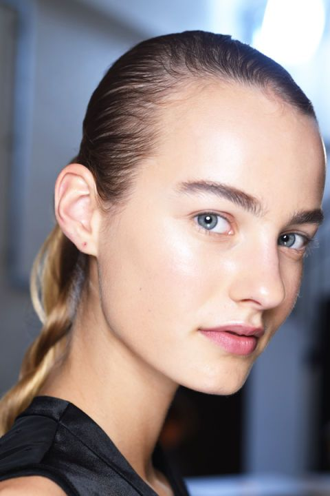 """Minimal makeup retuned to London Fashion Week at J.W. Anderson, where NARS products were used to achieve perfect skin and """"bring back the brow bone"""". Will this spur-on the return of arches in place of straight, statement brows? It's baby steps."""