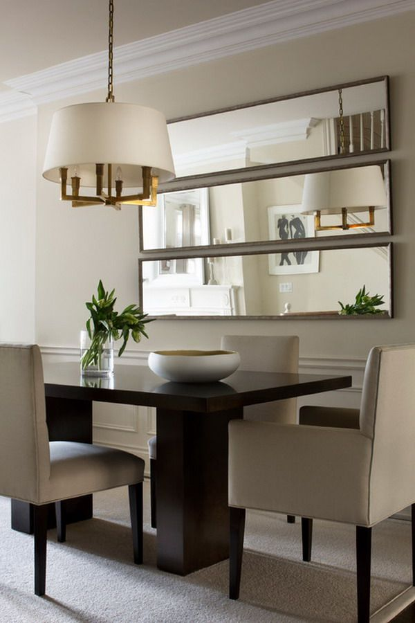 the treatment of the mirrors is especially great for a small dining room, as the room will instantly double in size