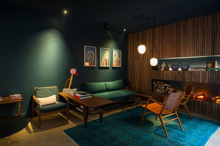 Dark green wall, living room with midcentury modern details.