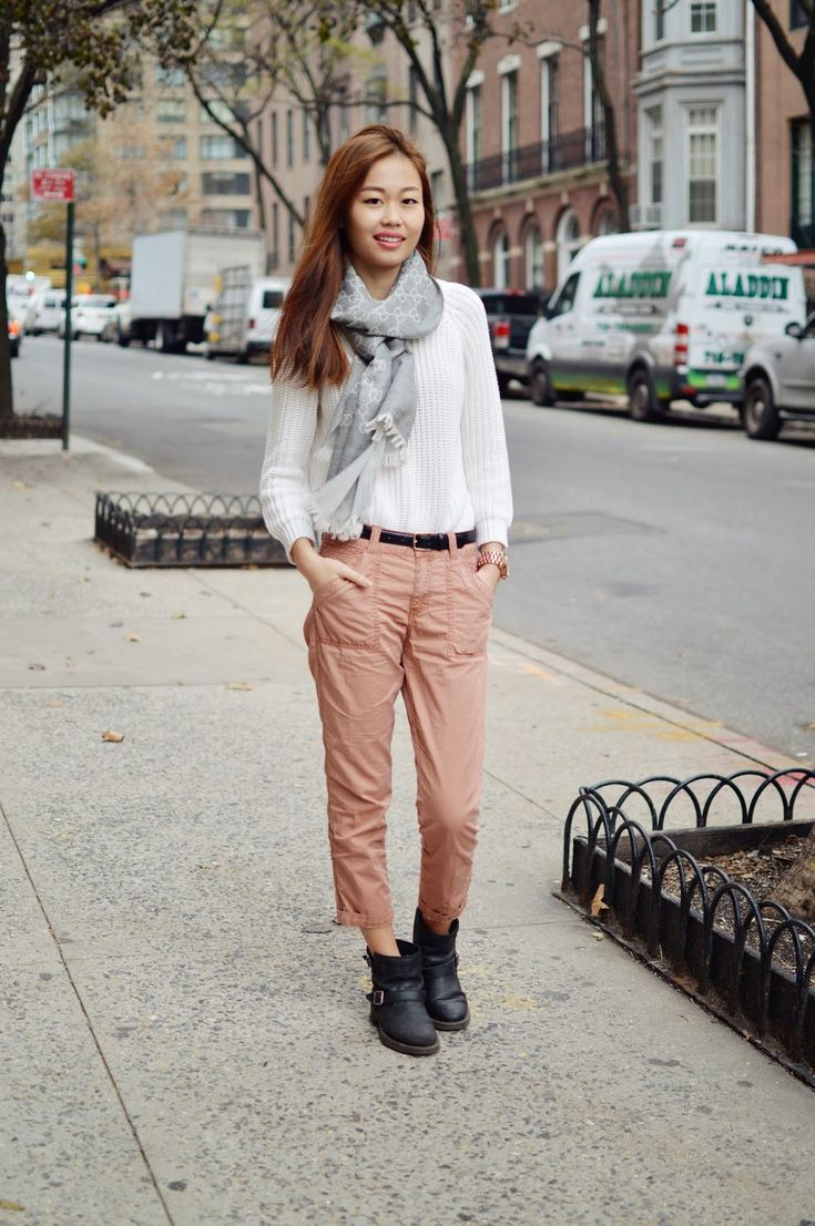 Shop this look on Lookastic:  http://lookastic.com/women/looks/scarf-cable-sweater-chinos-ankle-boots-belt/6401  — Grey Geometric Scarf  — White Cable Sweater  — Khaki Chinos  — Black Leather Ankle Boots  — Black Leather Belt