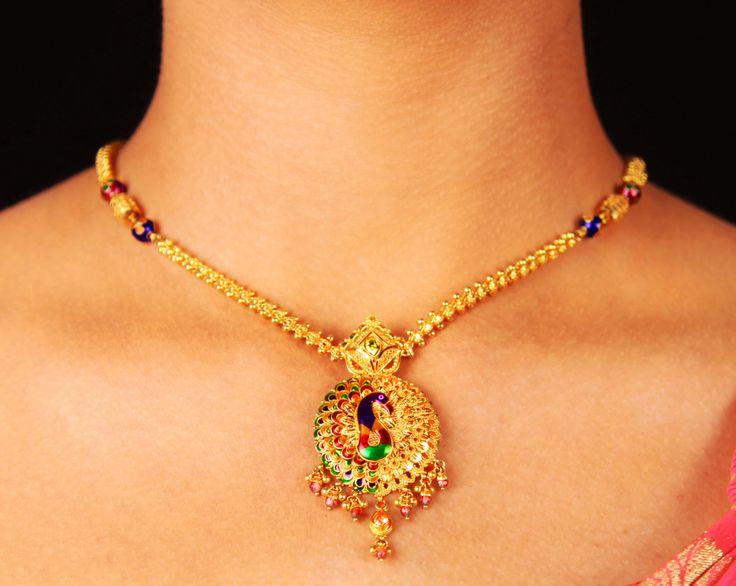 Peacock designed pendant #Gold #Chain #Indian #Ethnic #SreeAnnaiJewels #Jewelry. #SreeAnnaiJewels For Bookings call: 9994948767 http://www.sreeannaijewels.in/