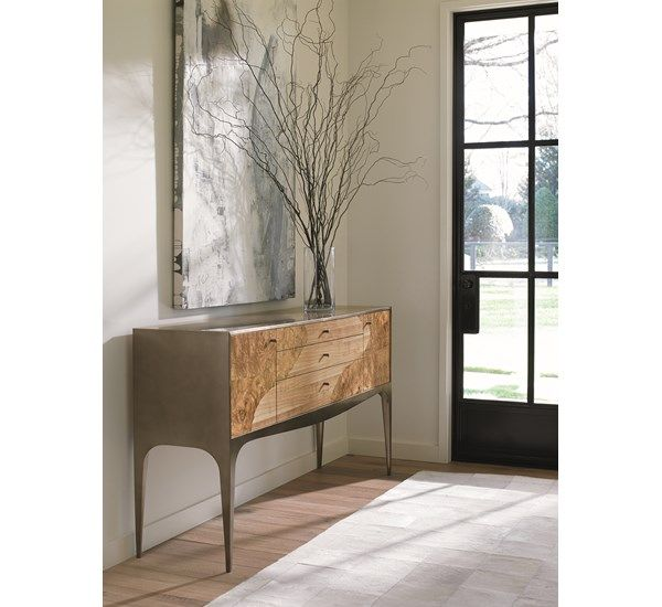 Trailblazer : Bring an earthy aesthetic to the dining room with this updated, mid-century modern sideboard. The interesting, contrasting patterns of the wood grains of the Olive Ash Burl and Longwood veneers come together to create a sleek yet natural composition, with a handsome Brushed Antique Brass metal base.
