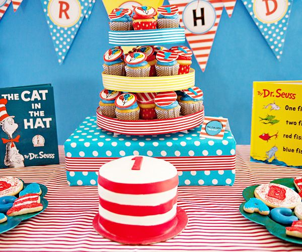 Dr. Seuss cake and cupcakes with books as party decorations.