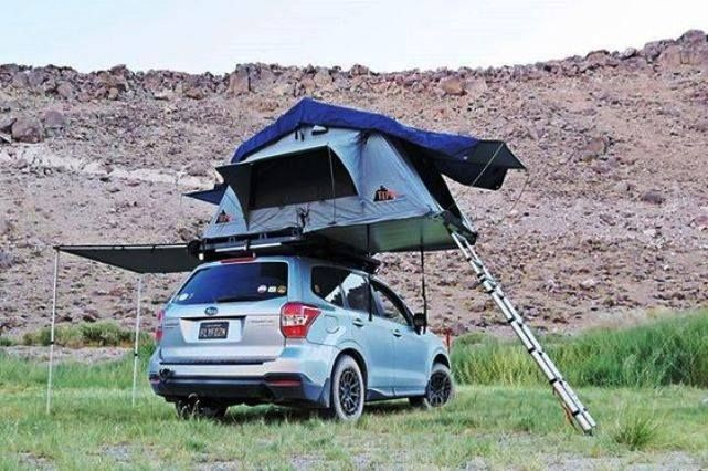 Nice example of car camping a Tent Topped Subaru Forester.
