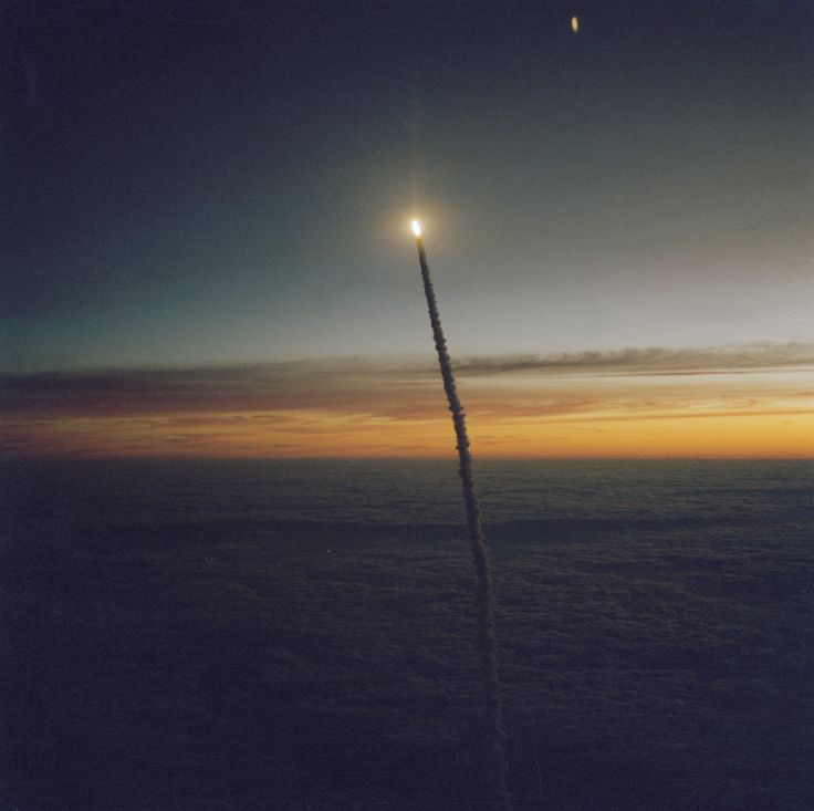 The Space Shuttle Challenger launches from Florida at dawn. On this mission, Kathryn Sullivan became the first U.S. woman to perform a spacewalk and Marc Garneau became the first Canadian in space. The crew of seven was the largest to fly on a spacecraft at that time, and STS-41G was the first flight to include two female astronauts.