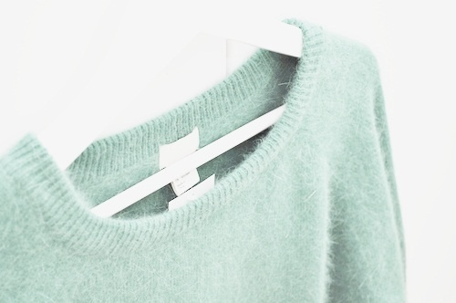 Mint green fuzzy sweater.