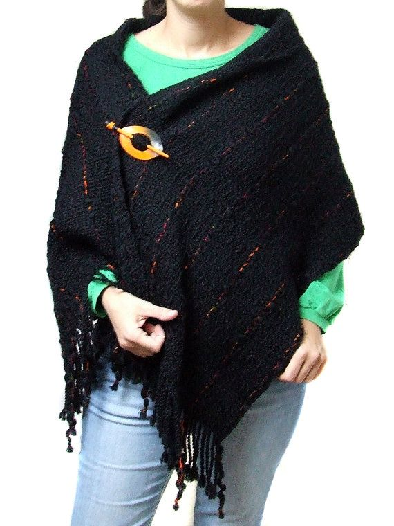 This large shawl is hand woven with wool and some acrylic. It goes with handmade polymer clay brooch / shawl pin,both in black and orange. It can be wear as a shawl and as a poncho. It will warm you in cold days. Soft and beautiful. Width : cca. 48 cm / 18,9 in Length: cca. 146 cm / 57,5 in (without fringe) Brooch : cca. 8,5 cm / 3,3 in Hand wash in cold water,lay flat to dry. Hand made in my studio free of smoke and pats. If you want to see the other shawls in my shop,vis...