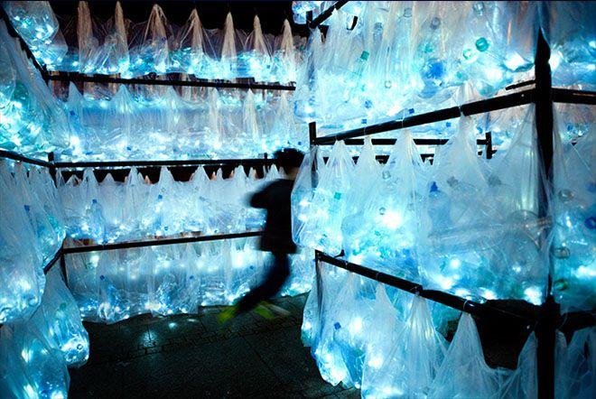 Labyrinth of iluminated plastic waste by Luzinterruptus