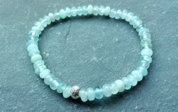 Beautiful gemstone bracelet with natural A quality aquamarine roundelles 4x6mm and a sterling silver ohm  #gemstone #healing bracelet #handmade jewelry #healing crystals #handmade jewelry #chakra stenen #sieraden
