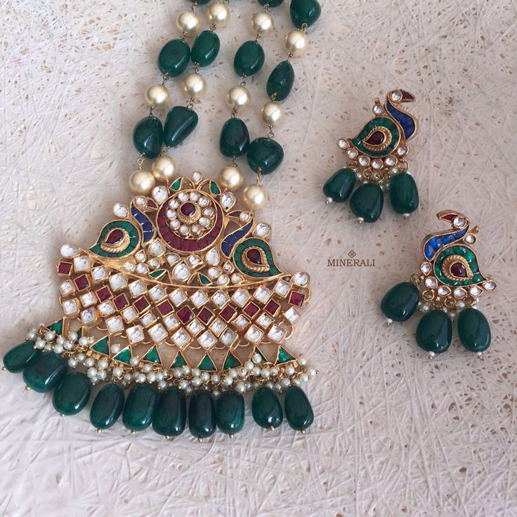 Pretty peacock earrings with a matching necklace in a gorgeous emerald shade will make sure all eyes are on you, this wedding season. By RaAbta, available at Minerali. #minerali_store #raabta #peacock #necklace #earrings #jewellery #weddingjewellery #designer #love #linkingroad #bandra #minerali