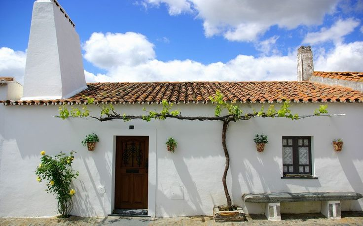 Charming: white-washed houses and villages nestle among the rolling hills, Alentejo, Portugal