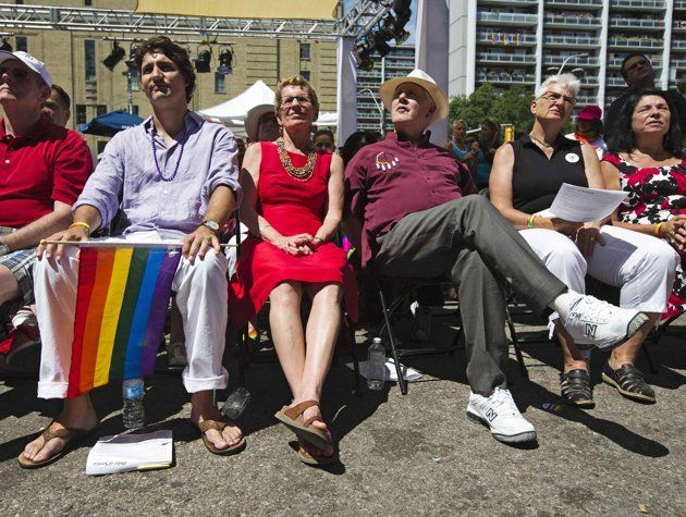 Liberal Party of Canada leader Justin Trudeau (L), Canada's first openly gay Ontario Premier Kathleen Wynne (2nd L), former interim leader for the Liberal Party of Canada Bob Rae (2nd R). and Wynne's partner Jane Rounthwaite (R) attend an outdoor church service before the gay pride parade in Toronto, June 30, 2013.
