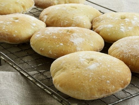"""How to make Stottie cakes (Originating from North East England, the Stottie cake is also known as oven """"bottom bread,"""" """"stotties"""" or """"stotty."""" This dense round bread is famous for its doughy consistency and heavy bottom, sturdy enough to hold a filling of eggs and bacon, ham or sausage while also soaking up meat juices without becoming soggy.)"""