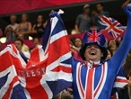 A fan shows his support and women's Handball
