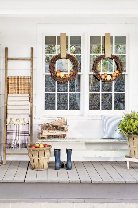 Spruce up your entry with these simple, seasonal, use-what-you-have ideas. If you have a wooden ladder: Display a cozy blanket on each rung. If you have a grapevine wreath: Dress it (or a pair) up by nesting nuts and apples in the lower half.