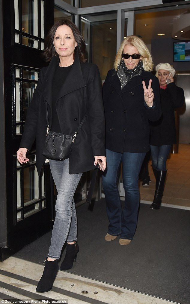 They're back! Bananarama singersKeren Woodward, Sara Dallin and Siobhan Fahey, left the Radio 2 studios in London in matching black jackets and jeans on Thursday