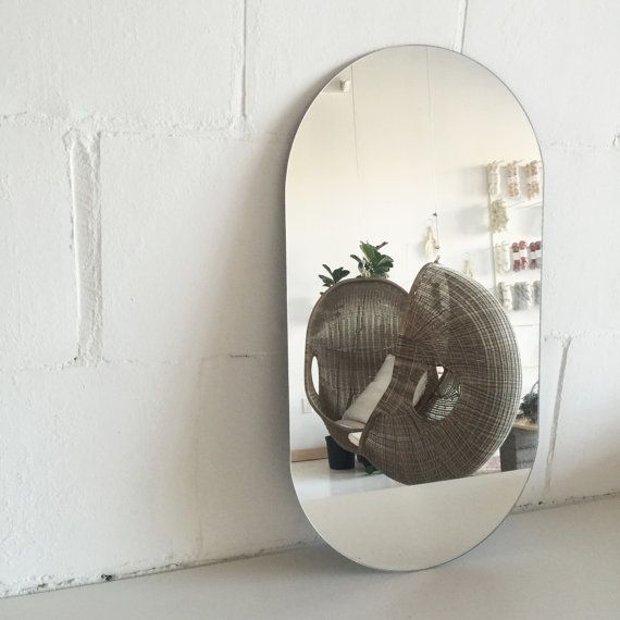 A modern frameless mirror that measures 16 x 32. Can be mounted with mirror clips (from Home Depot or other hardware stores) or with mirror adhesive for a clean look.  Made to Order.