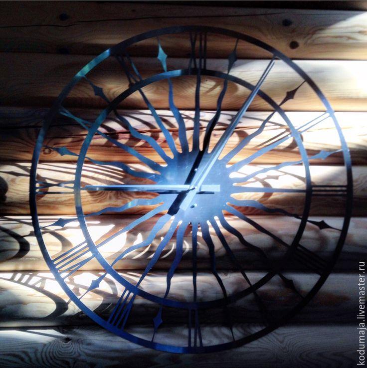 "Wall clock ""Vana Tallinn - aisi"" 100 cm (1m). Made of stainless steel. Roman number. Metal in interior. Clock. Vana Tallinn. Sun. Stainless steel. Stainless steel in interior. Metal. Big clock. Clock 1 metre."