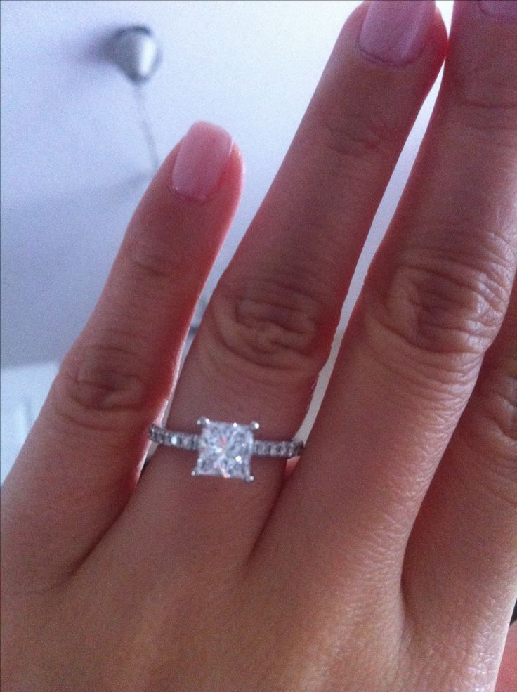 Princess cut engagement ring with mini diamonds.