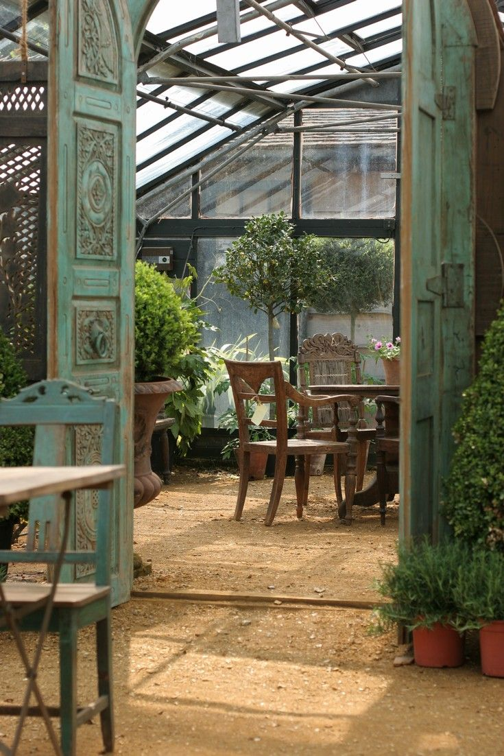 Some day, I'd love to have a greenhouse (especially one with doors like that!). [Petersham Nurseries]