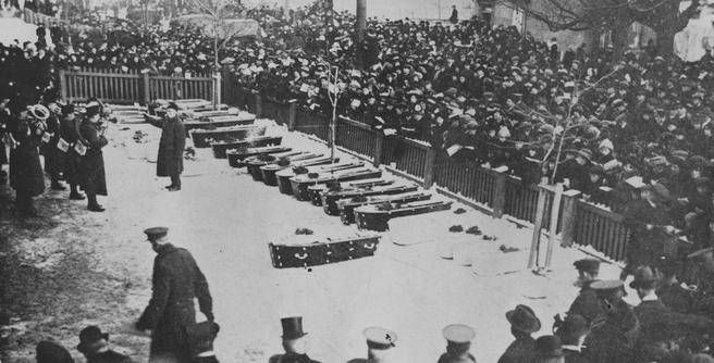 A brass band plays as some of the nearly 2,000 people killed in the Halifax Explosion lie in coffins awaiting burial. The December 6, 1917 explosion wiped out most of the city's north end and left 10,000 of the city's 65,000 residents homeless.