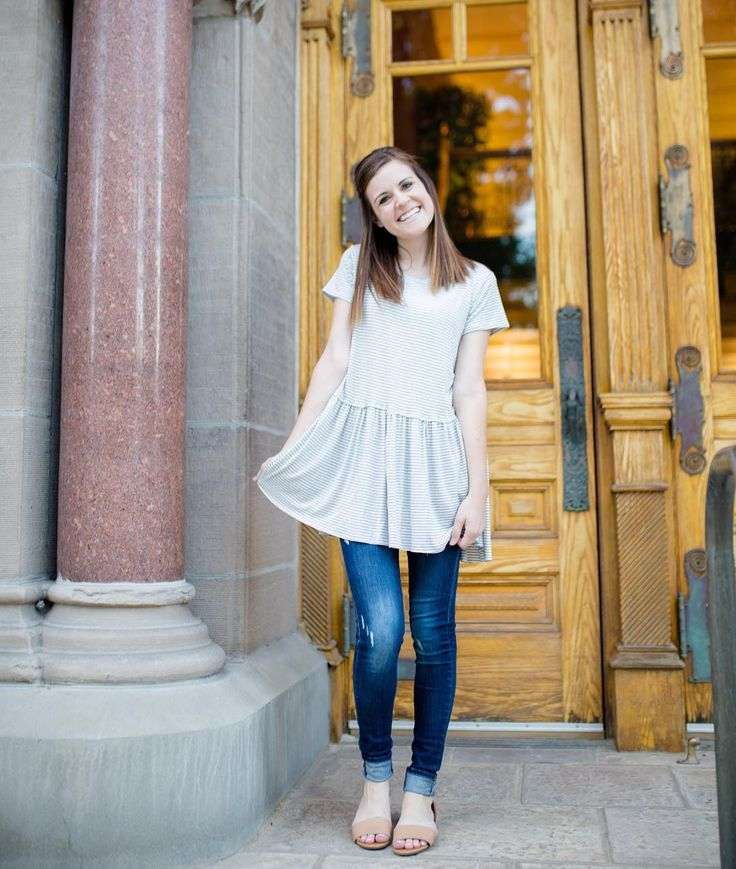 I love this cute peplum shirt. Cute modest fashion with ripped jeans and tan sandals www.everyday-ellis.com