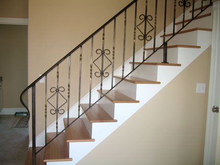 Wooden Staircase With Wrought Iron Railing. Interior ...