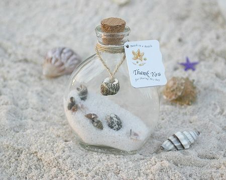 Wedding Favors    http://www.fullweddingsources.com/wp-content/uploads/2011/06/beach-wedding-favors-bottle-with-shell-and-sand.jpg