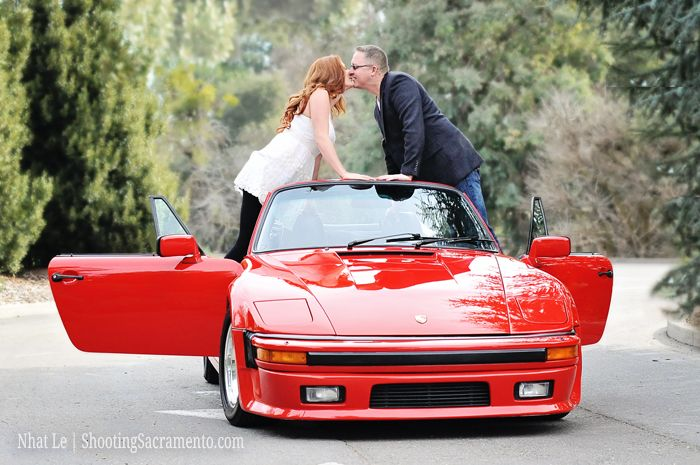 Couple posing idea with red car for engagement session.  Image by ShootingSacramento.com