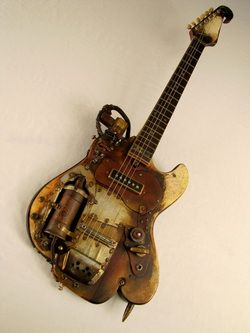 Found buried with an unidentified body in an Alabama cornfield in 1971. Cleaned up pretty well: has new strings. Abombcaster guitar Tony Cochran electric guitars.