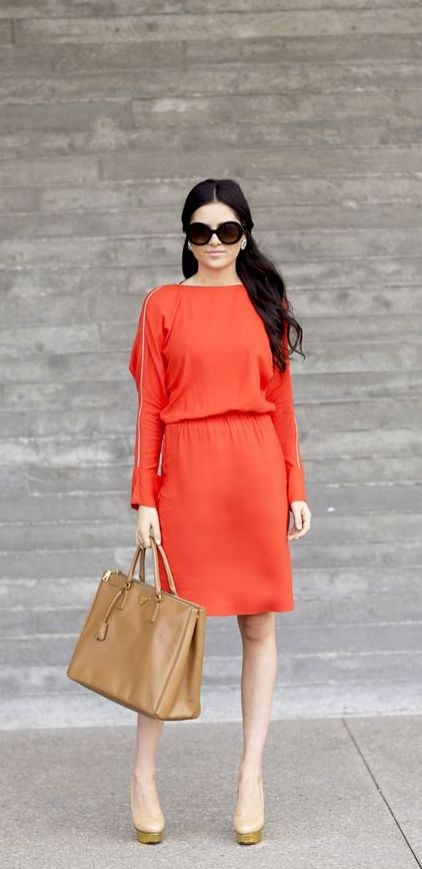 Work week to weekend wear in a bright red-orange dress.