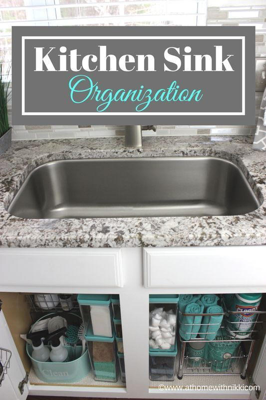 Organise the area under the sink with a handy caddy, clear tubs and pull-out drawers on gliders to keep everything organised and accessible