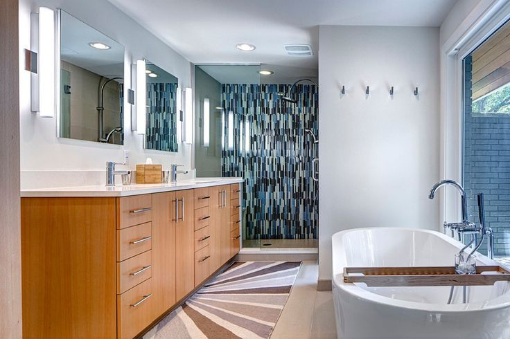 Bathroom Interior With Decorative Ceramic Tile In The Shower Room And White Bathtub Along With Double Sink And Wooden Cabinet Also Frameless Mirrors American Storey House Mid-20th Century With Retro Details In The Interior Home design http://seekayem.com