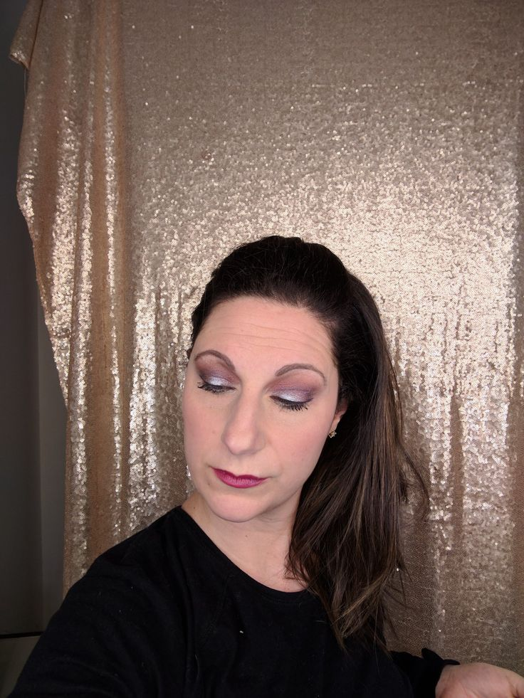 Younique palette 5. Bold and bright, shimmery colors. I used corals, purples, and silver.  Fiber mascara and black liner.