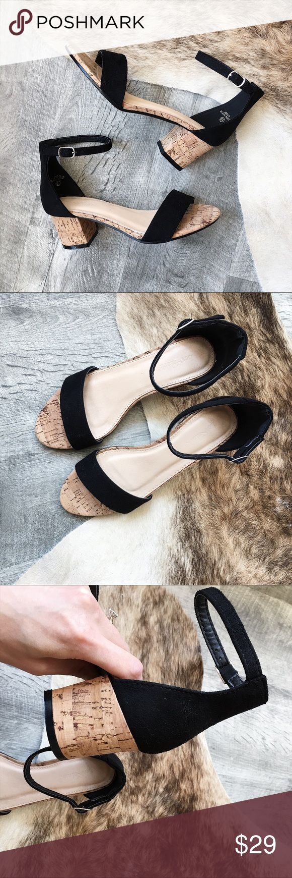 """Cork Heel Sandal Cute minimal sandal with faux black suede upper and adjustable ankle strap and 2.6"""" cork heel! Not ASOS brand but similar style.   * man made  * boutique brand  * New with original box * True to size   👉🏼 Want to negotiate? Please use the offer button. 👉🏼 Bundle with one more item for an instant 20% off! 👉🏼 Sorry, no try-ons or trades. Asos Shoes Sandals"""