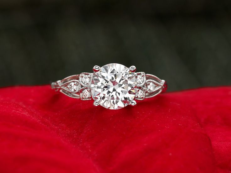 This vintage-inspired ring features six glittering round accent diamonds in a delicately sculpted design, showcasing the center diamond. #BrilliantEarth