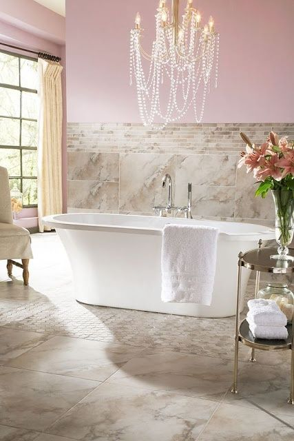 Gorgeous Pink Bathroom with Chandelier over the Bathtub