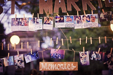 Photos displayed of on clothesline. Deff want to do this with our photos from all the years we've been together.