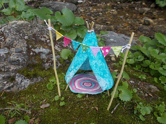 Miniature Fairy Garden Teepee 6 H. This teepee is aqua with a scroll design on the fabric. Raw cut fabric edges are part of the teepees charm. Fabric is lightly starched to help hold form, and edges have been treated to prevent fraying. The rug is crocheted with coordinating colors and finished with a scalloped edge. Banner has 7 flags, each with a different pattern and has been treated to hold form and avoid fraying.  Teepee is approximately 6 tall, Teepee Poles 7, Rug 4 1/2 diameter, B...