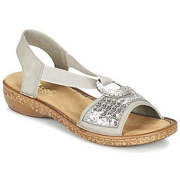 Als je deze zomer modieus voor de dag wilt komen, dan is deze open schoen van Rieker in de kleur zilver echt iets voor jou! Om je zeker te verleiden is de schacht gemaakt van synthetisch materiaal en de zool van synthetisch materiaal. Je kunt de verleiding van deze comfortabele schoenen met synthetische binnenvoering en synthetische binnenzool niet weerstaan! Dankzij de hak van 4 cm wint deze open schoen aan elegantie! - Kleur : Zilver - Schoenen Dames € 64,95