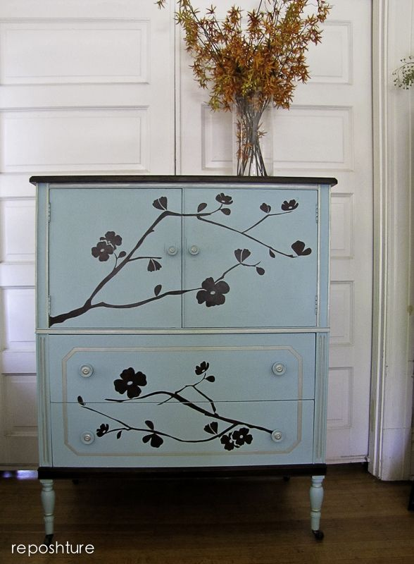 Light blue painted armoire, with stencil design