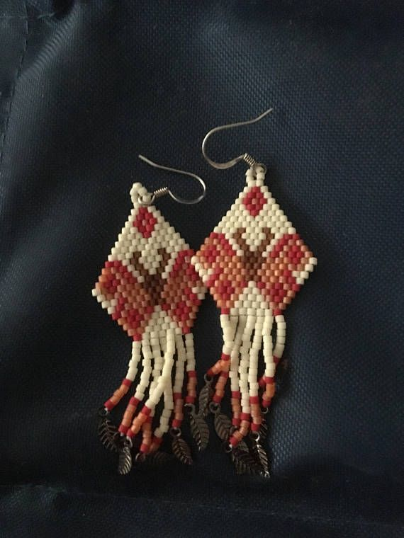 These lovely earrings were made by a native friend of mine and passed along for me to sell. Quite light and delicate, they are hand beaded and ready to ship. This is for your choice of one pair listed. In the event of more than one pair purchased, I will waive additional shipping