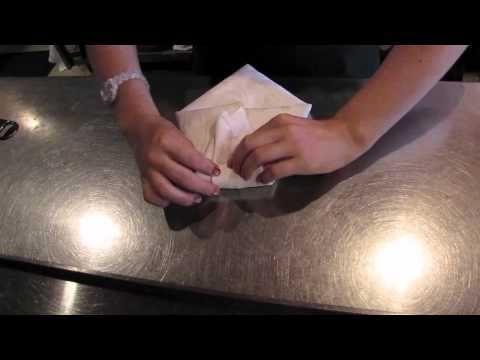 "Jessica White demonstrates the ""Tuxedo"" napkin fold at Didier Restaurant in Toronto, Canada."