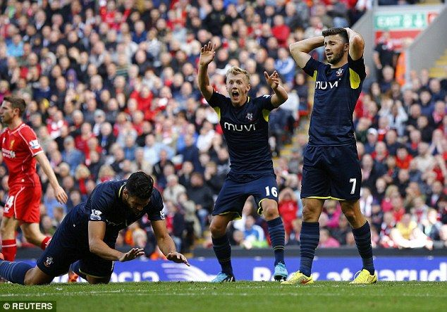 So close: Ward-Prowse (centre) and Shane Long (right) react after a missed opportunity at Anfield