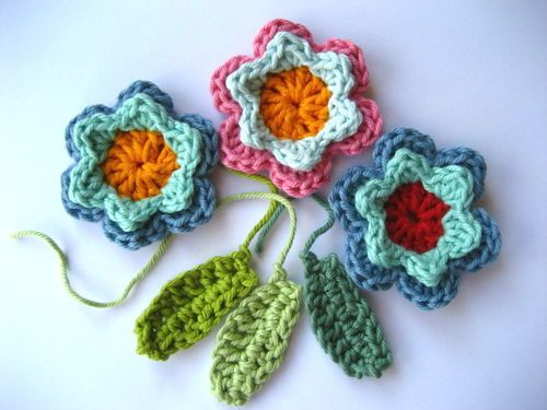 Fun crochet flowers to make into broaches or barrettes or decorate gifts with.