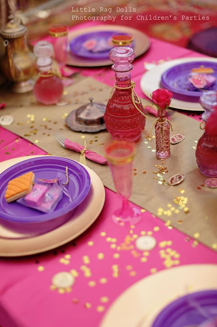 Cute! Pink plastic tablecloth with gold wrapping pear runner, ways and cost, purple paper plates.