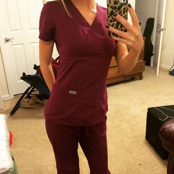 """Grey's Anatomy Wine Scrub Set Grey's Anatomy """"Wine"""" scrub set. High quality scrub brand by Barco. Gently worn but still in excellent condition. Original price for a set of these scrubs is over $50 a set. XS top. XXS Tall bottoms. Willing to sell top or bottom separately for $20 each. Barco Other"""