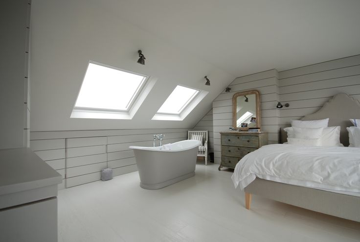 loft conversion bedroom with cast iron bath featured on sarah beeny